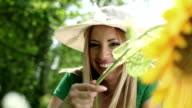 Woman with sunflower video