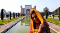 Woman with Taj Mahal entrance at the back video