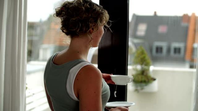 Woman with Tea Cup next to Window video