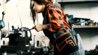 Woman work on Lathe video