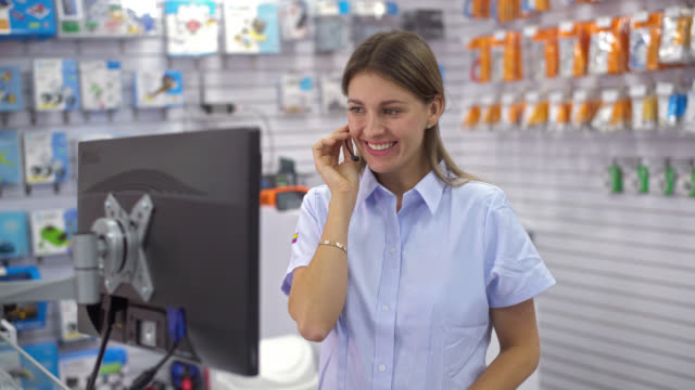 Woman working at an electronics store video