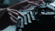 DS Woman working fast on an old typewriter video