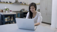 Woman working from home very happy on her laptopBeautiful asian woman working from home very happy on her laptop video