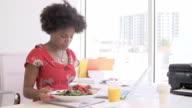 Woman Working In Design Studio Having Lunch At Desk video
