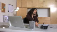 Woman working in home office video