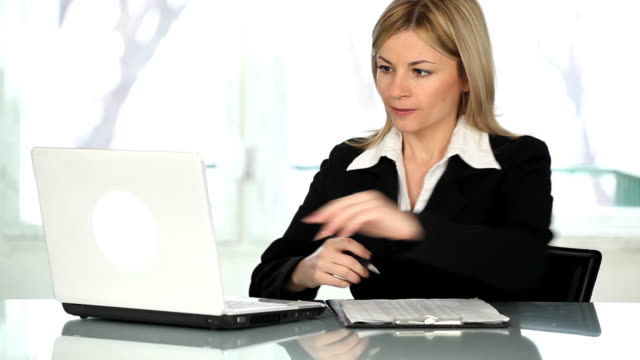 Woman working in the office. video
