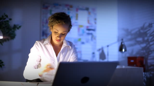 Woman working late into the evening video