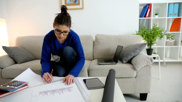 Woman working on finances video