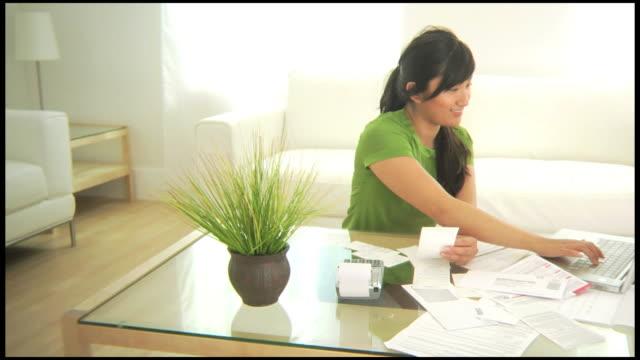 Woman working on finances video