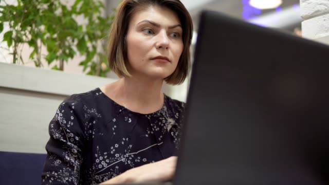 Woman working on her laptop during her break video