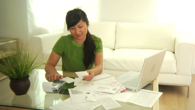 Woman working on personal finances video