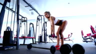 Woman working out at the gym with dumbbells video