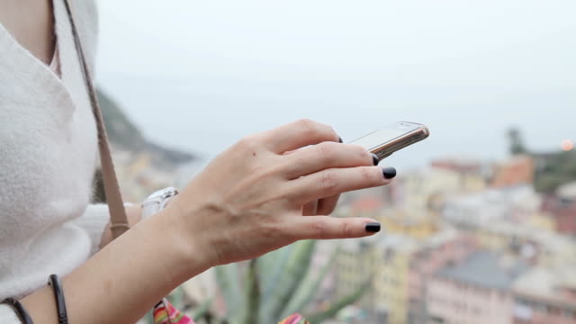 Woman working using Ipad at Vernazza, Cinque Terre View from high hill Background video