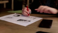 Woman working with documents graphs video