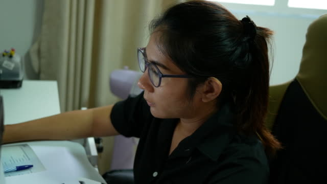 Woman working with her data, 4k(UHD) video