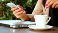 Woman working with her phone on cafe video