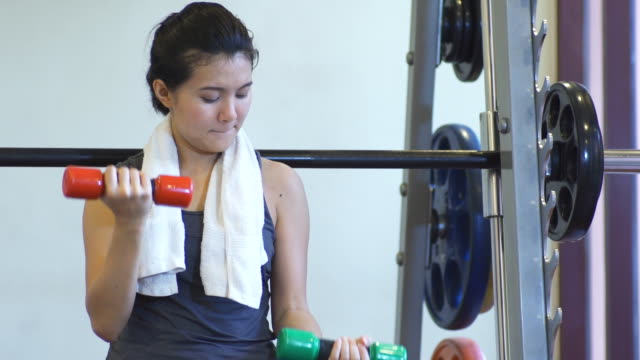 Woman Working With Weights In Gym video