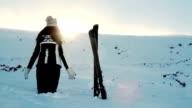 Woman Worship Pose Mountains Sun Flare Ski video