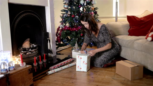 Woman wrapping Christmas Presents video