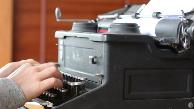 Woman writer writing on antique typewriter video