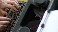 Woman writer writing on antique typewriter video