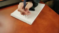 woman writing to do list video