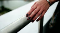 woman's hand slides over the railing video