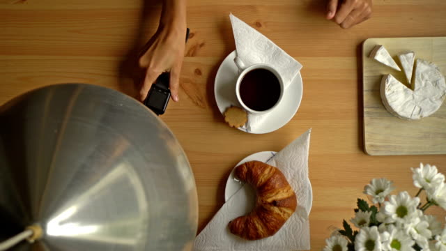 Woman's Hand Takes A Cup Of Coffee And A Smart Watch. Top View. video