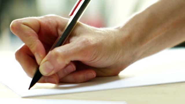 Woman's hand writing video