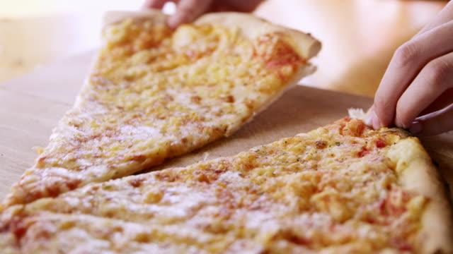 CU Woman's hands grabbing piece of pizza video