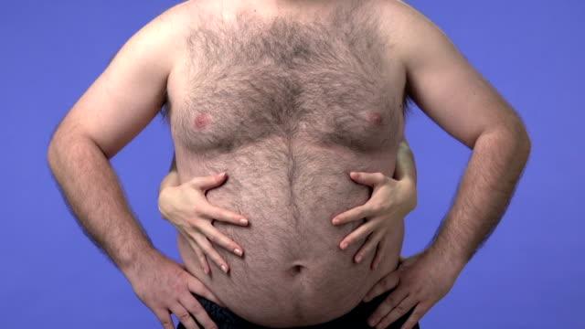 Woman's hands hugging an overweight man video