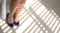 Woman's hands putting on heels. video