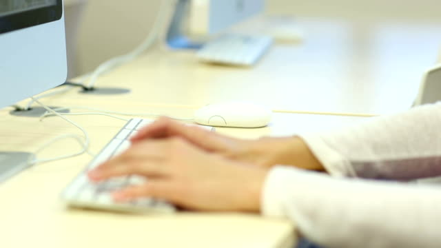 Woman's hands typing on a computer keyboard video