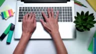 Woman's hands typing on laptop keyboard video