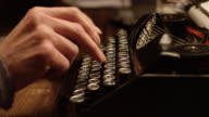 DS woman's hands typing on old typewriter video