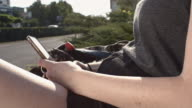Woman's hands using a smartphone in the city video
