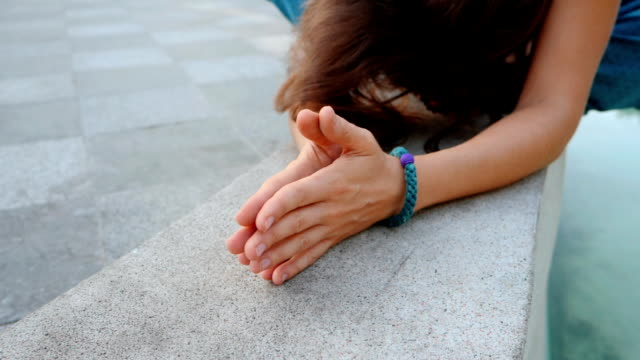 Woman's hands with bracelets together symbolizing prayer and gratitude. Mudra. Yoga concept. Camera movement from right to left. Slow motion video
