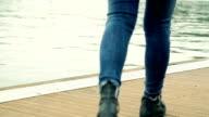 woman's legs near the river video