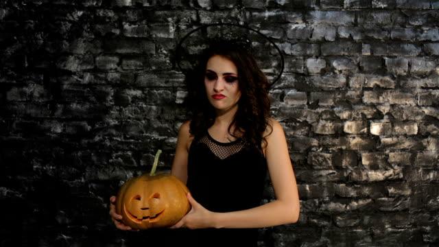 Woman-sorceress holds a pumpkin video