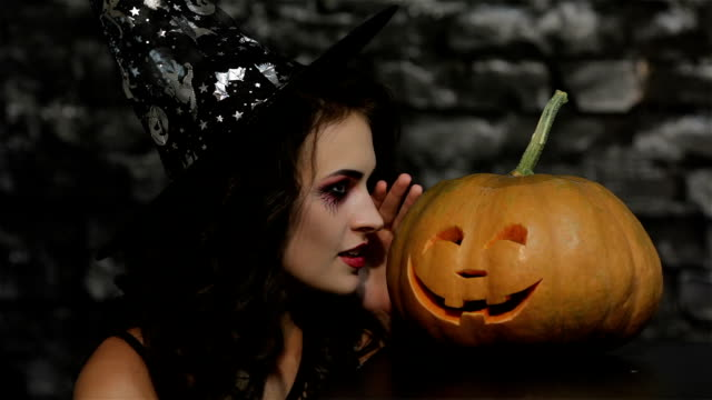 Woman-sorceress makes a gesture shh video