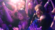 Women and Girls dancing and cheering in club during party video