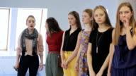 Women are preparing fashion show in model school video