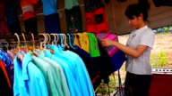 Women are shopping for clothes video