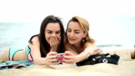 Women at the beach taking selfies. video