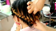 women braid hairstyle in beauty salon video