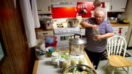 Women Canning In Kitchen video