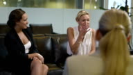 Women chatting in a corporate office setting video