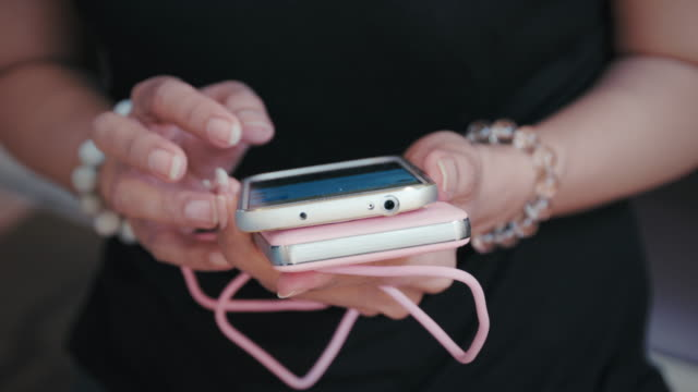 Women chatting on mobile phone video
