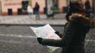 Women Checking the City Map on bus station video