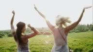 Women cheering outdoors on roadtrip video